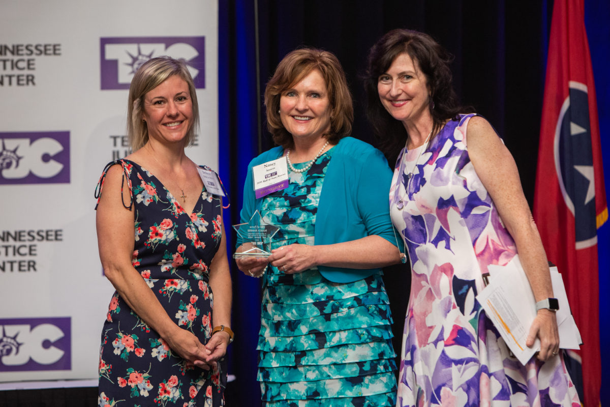 Debbie McBryar Miller, Tennessee Justice Center client and 2019 Mother of the Year; Nancy Anness, Chief Advocacy Officer at Saint Thomas Health and Tennessee Justice Center's 2019 Hall of Fame Honoree; and Michele Johnson, Executive Director of Tennessee Justice Center; photographed by Nathan Morgan